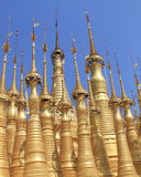 Golden Pagodas of Shwe Indein 2. The Shwe Indein Pagoda (Burmese) is a group of Buddhist pagodas in the village of Indein, near Ywama and Inlay Lake in Shan Stock Image