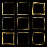 Golden paint strokes square frames set. Collection of golden grunge brush stroke square frames  over black background. Design elements set. Vector illustration Royalty Free Stock Photos