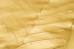 Golden painted art background texture selective focus. Golden color painted art background texture selective focus stock photos