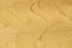 Golden painted art background texture selective focus. Golden color painted art background texture selective focus stock photography