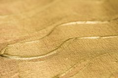 Golden painted art background texture selective focus. Golden color painted art background texture selective focus royalty free stock photography