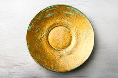 Golden painted decorative plate Royalty Free Stock Images