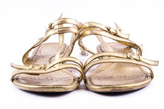 Golden painted, elegant, party shoes on a white background - front Royalty Free Stock Photo