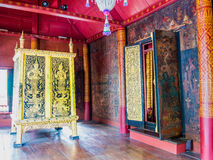 Golden painted  wooden cabinet of tripitaka in Thailand. Royalty Free Stock Photography
