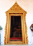 Golden painting stucco door frame, Thai ancient temple. Stock Images