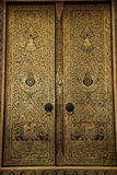 Golden painting on the ubosot door Royalty Free Stock Photo