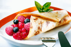 Golden pancake filled with berries Royalty Free Stock Image