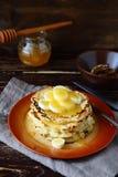 Golden pancakes with banana sauce Stock Photos