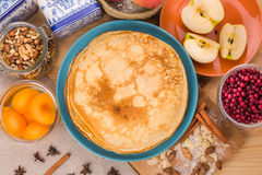 Golden pancakes in a blue plate top view Royalty Free Stock Photography