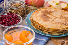 Golden pancakes in a blue plate Stock Photo