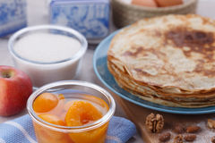 Golden pancakes in a blue plate Royalty Free Stock Photography