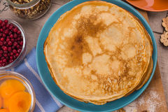 Golden pancakes in a blue plate Royalty Free Stock Photos