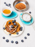 Golden Pancakes with fresh blueberries in plate Stock Photo