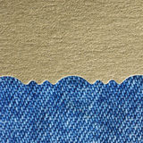 Golden paper and blue jeans Royalty Free Stock Photo