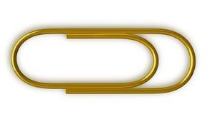 Golden paper clip  Stock Images