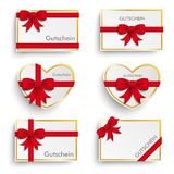 Golden Paper Coupons Set Red Ribbons Stock Photography