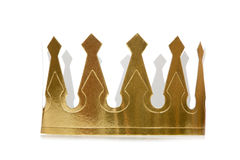 Golden Paper Crown. Paper golden crown on white background with copy space royalty free stock photo