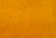 Golden paper with gold thread. Royalty Free Stock Photo