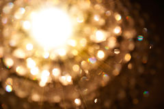 Golden particle of lights. Burst from the bright light Royalty Free Stock Image