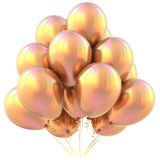 Golden party balloons happy birthday decoration yellow glossy Royalty Free Stock Photos