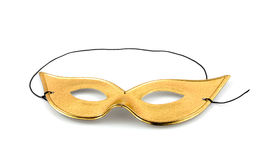 Golden party mask. Isolated on white background Royalty Free Stock Photography