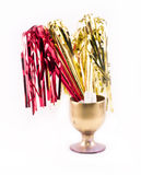 Golden party whistles with stripes gathered in a golden glass Royalty Free Stock Photography