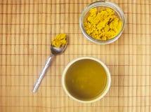 Turmeric tea with golden paste. Royalty Free Stock Photo