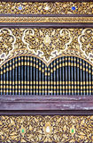 Golden pattern carving Stock Image