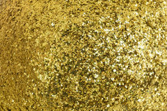 Golden pattern formed with shiny little pieces Royalty Free Stock Images