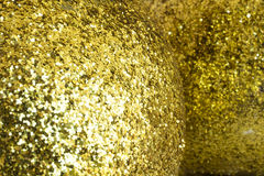 Golden pattern formed with shiny little pieces Royalty Free Stock Photos