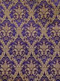 Golden baroque pattern on a violet background. wallpaper, fabric, deco fabric, furniture fabric stock photos