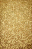 Golden pattern on wallpaper Stock Photo