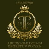 Golden patterned letters and numbers with initial monogram in coat of arms form. Elegant font and elements kit for logo. Design Stock Photo