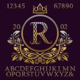 Golden patterned letters and numbers with initial monogram in coat of arms form. Elegant font and elements kit for logo. Design Stock Image