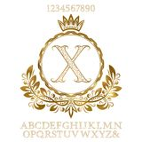 Golden patterned letters and numbers with initial monogram in coat of arms form. Shining font and elements kit for logo design.  Royalty Free Stock Photos