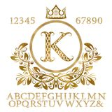 Golden patterned letters and numbers with initial monogram in coat of arms form. Shining font and elements kit for logo design.  Stock Photos
