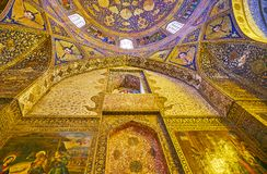 The golden patterns in Bethlehem church in Isfahan, Iran. ISFAHAN, IRAN - OCTOBER 20,2017: The wall of Armenian Orthodox Bethlehem Church in New Julfa is covered Royalty Free Stock Photo