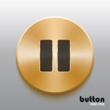 Golden pause button with black symbol. Round pause button with black symbol and brushed golden metal texture isolated on gray background Royalty Free Stock Image