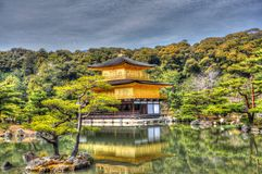 Golden pavilion. On the lake in Kyoto park Royalty Free Stock Image