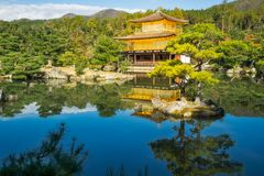 The Golden Pavilion Garden Landscape in Kyoto, Japan. The Golden Pavilion or Kinkaku-ji Temple and the beautiful surrounding Japanese Zen Garden, in the morning stock photo
