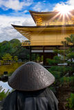Golden Pavilion, Japan. A buddhist monk looking at Kinkaku-ji (Temple of the Golden Pavilion) a Zen Buddhist temple in Kyoto, Japan Royalty Free Stock Image