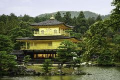 Golden Pavilion Kinkakuji Temple in Kyoto Japan in autumn or summer time stock photography