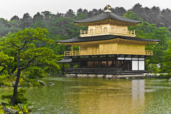Golden Pavilion Kyoto. Kinkakuji (Golden Pavilion) is a Zen temple in northern Kyoto, photo taken in the rain royalty free stock images