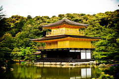 Golden Pavilion in Kyoto, Japan. Gold covered pavilion and its reflection Royalty Free Stock Images