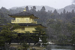 Golden pavilion in Kyoto Japan during a snow storm Stock Photo