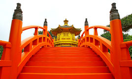 Golden Pavilion and red bridge royalty free stock images