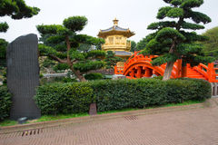 The Golden pavilion and red bridge in Nan Lian Garden near Chi Lin Nunnery, Hong Kong Stock Image