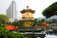 The Golden pavilion and red bridge in Nan Lian Garden near Chi Lin Nunnery, Hong Kong Royalty Free Stock Photography