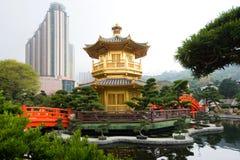 The Golden pavilion and red bridge in Nan Lian Garden near Chi Lin Nunnery, Hong Kong Royalty Free Stock Photography
