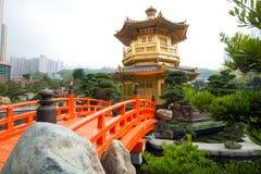 The Golden pavilion and red bridge in Nan Lian Garden near Chi Lin Nunnery, Hong Kong Stock Photo